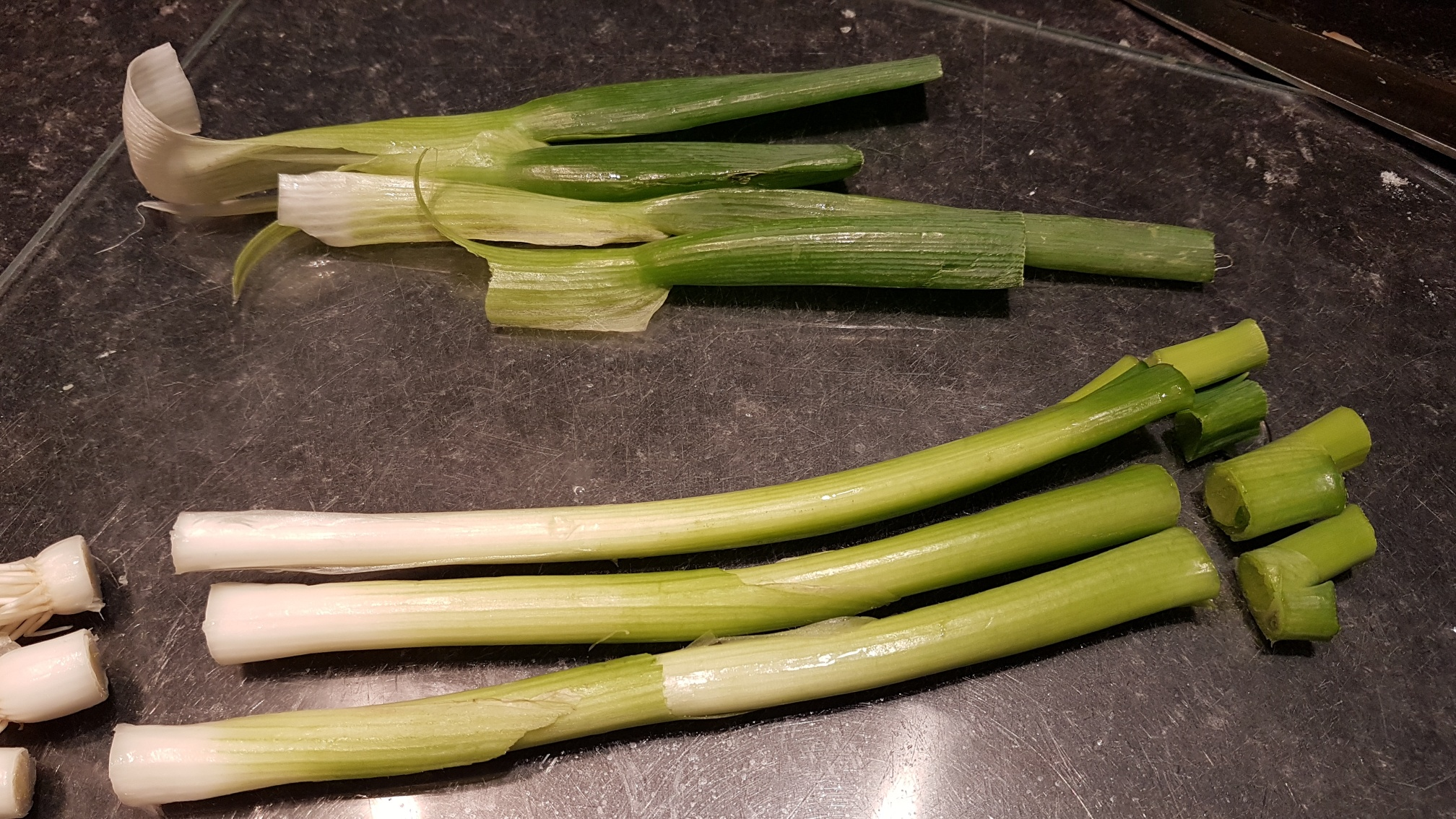 This image shows how to top and tail the spring onions